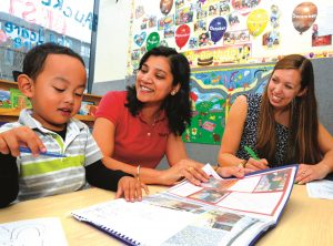 Alfroi with teacher Nisha Rani and early intervention teacher, Katherine Reilly